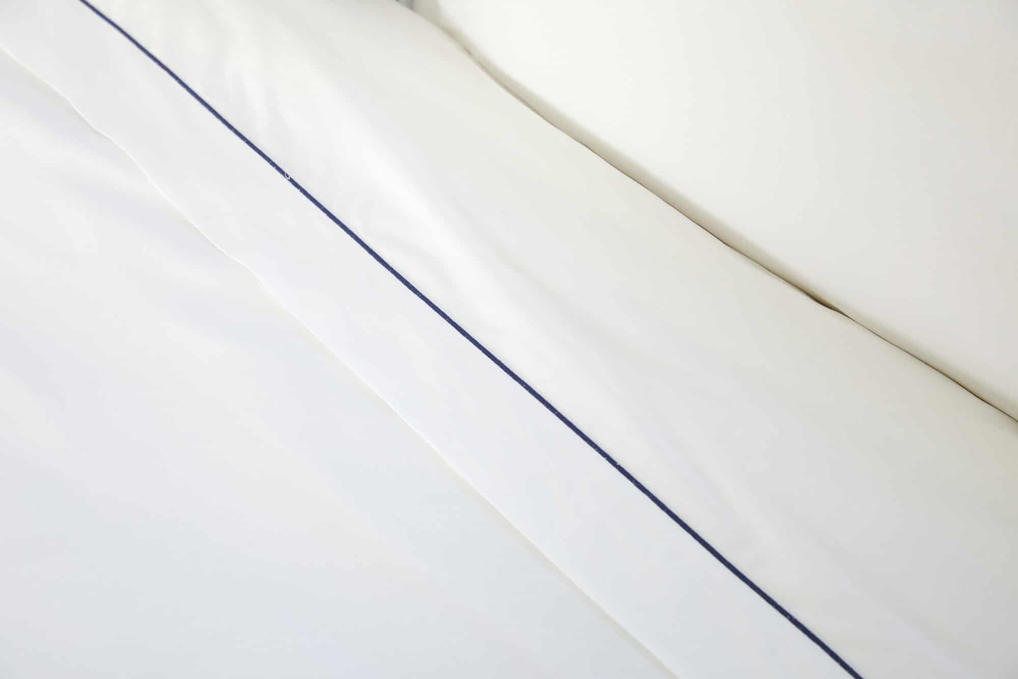 Sateen White Flat Sheet with Navy Rolenio